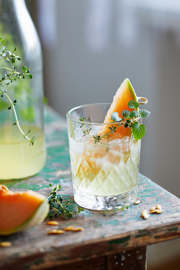Water kefir lemonade with candied melon and lemon balm