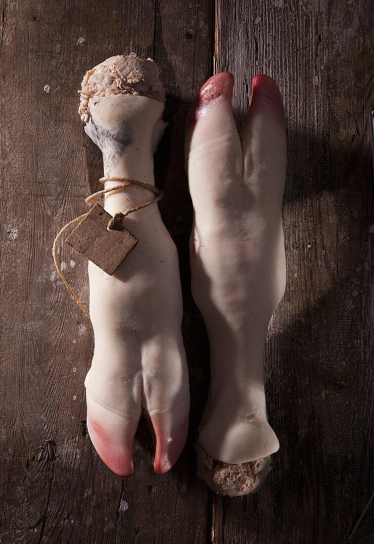 Pig trotters on wood