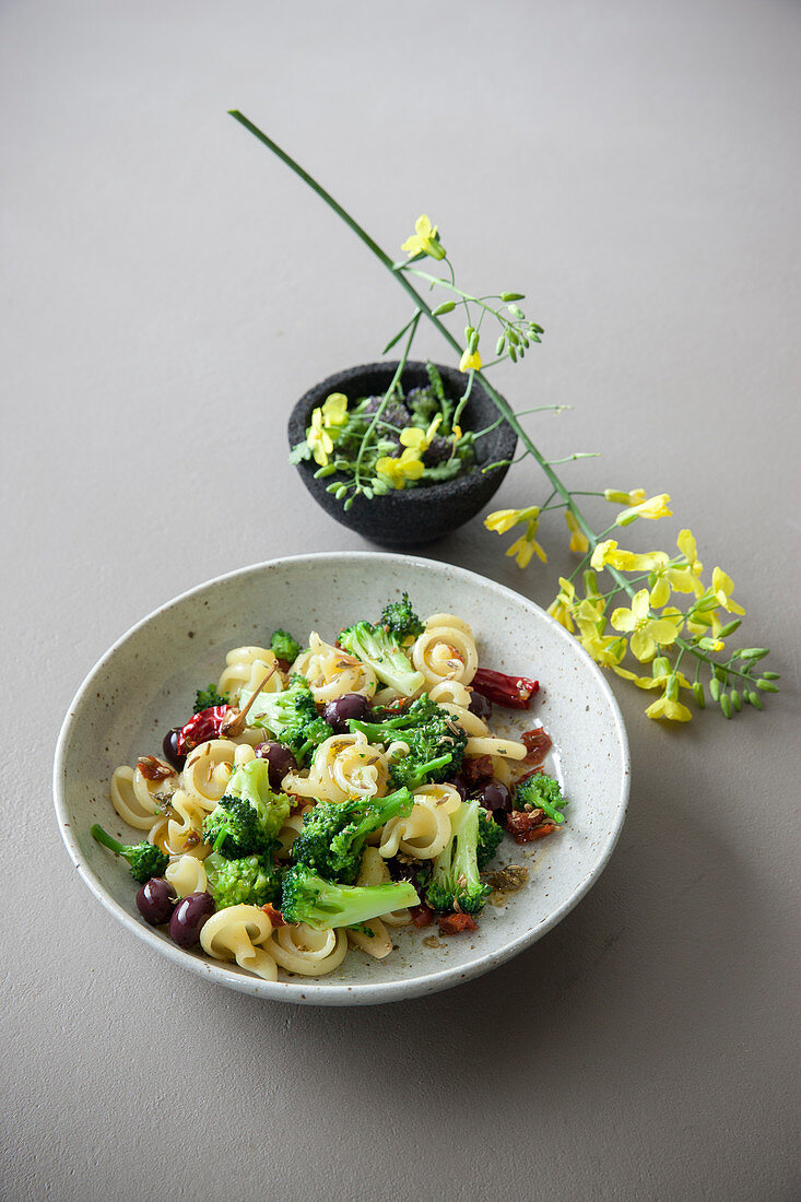 Pasta with broccoli, olives, tomatoes and orange blossom water