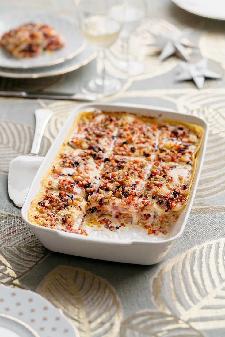 Lasagne with a winter vegetable sauce, stracciatella and amaretti crumbs