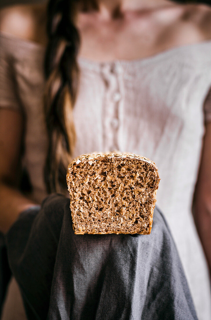 Woman Holding Honey Oat Bread