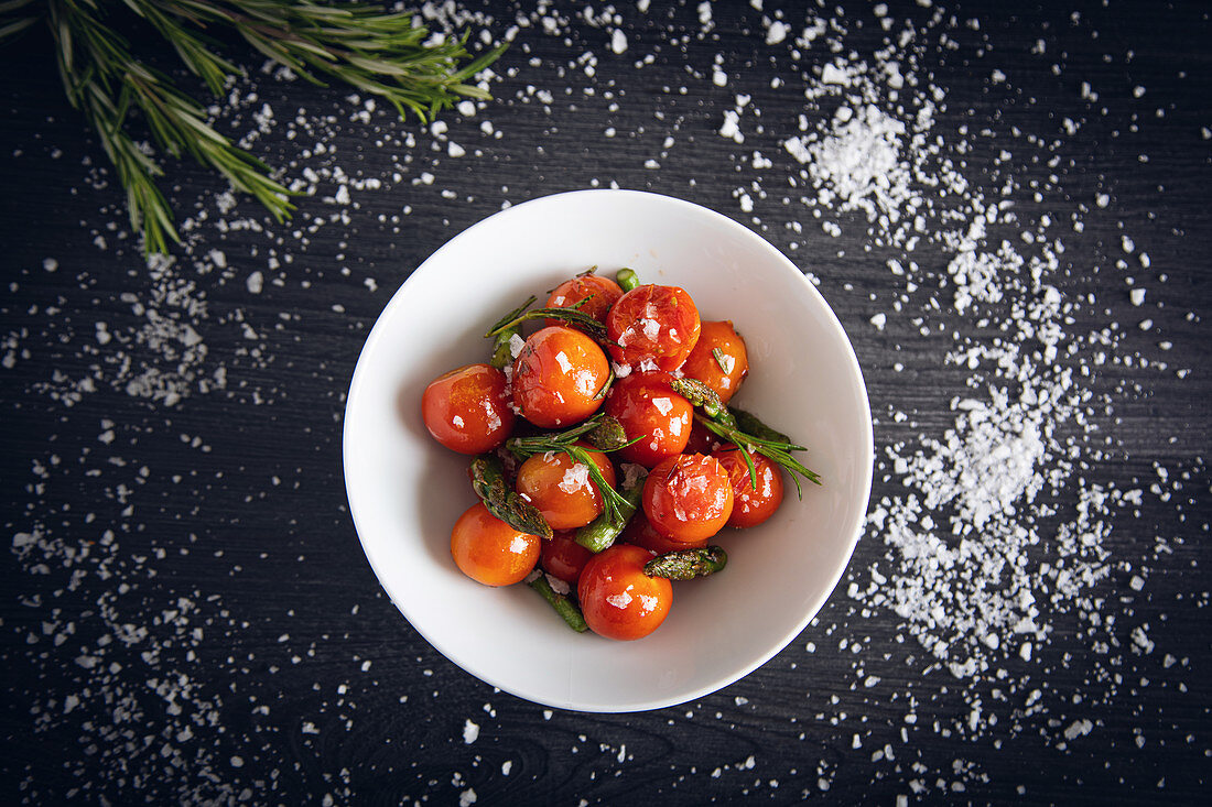 Fresh cherry tomatoes sauteed with green asparagus and rosemary