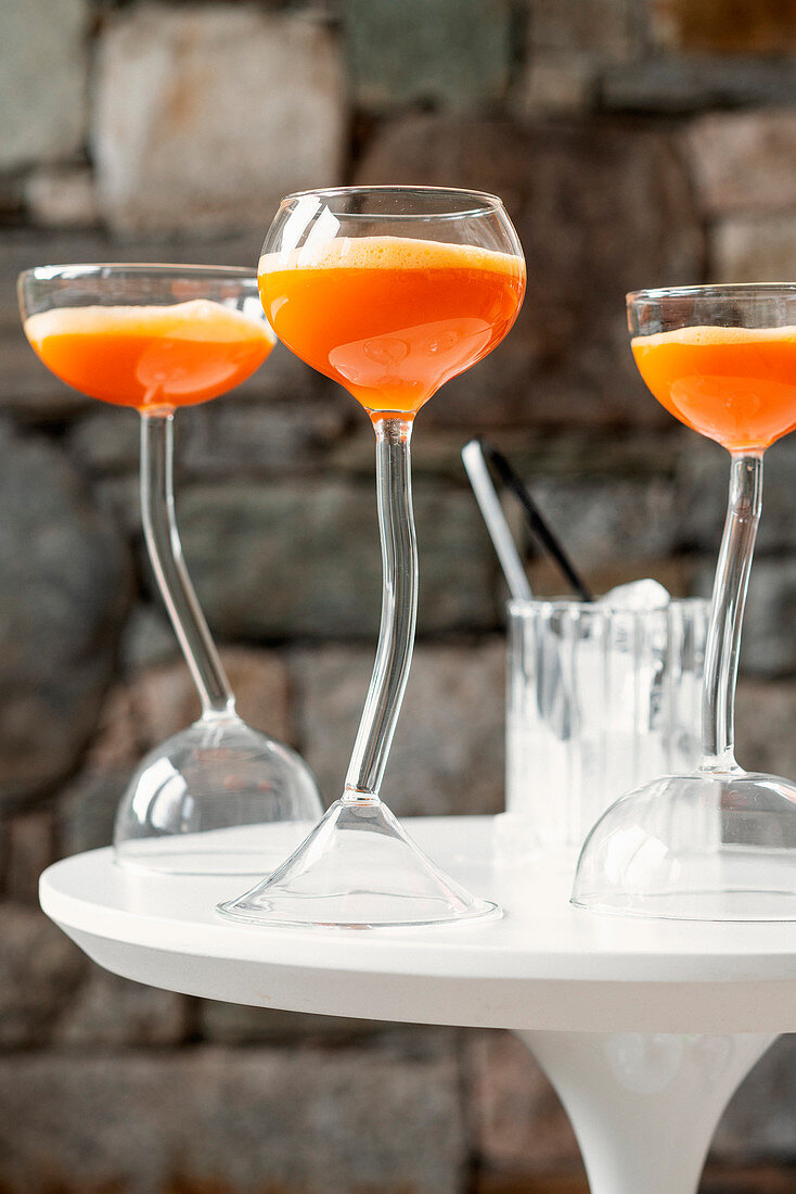 Welcome cocktail with whiskey and carrot juice