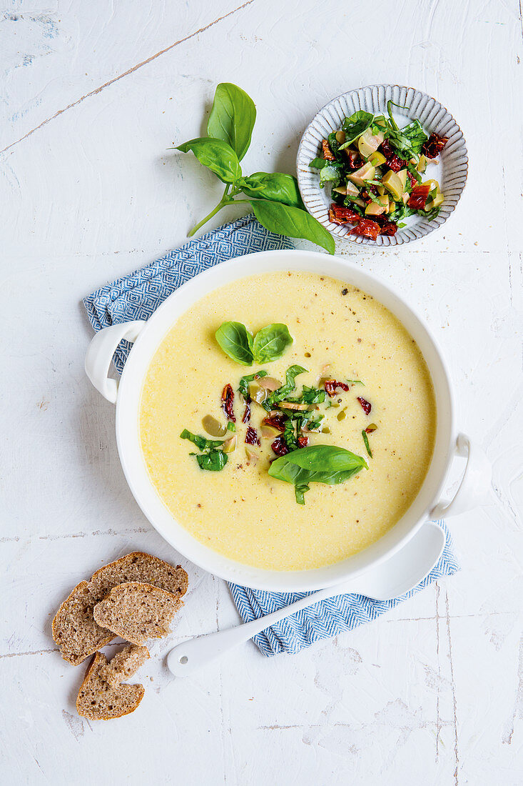 Yellow zucchini soup with spiced topping