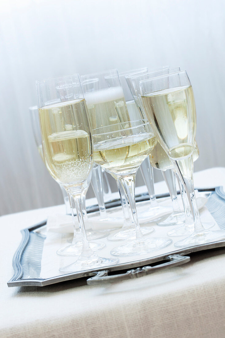 Glasses of champagne on a silver tray