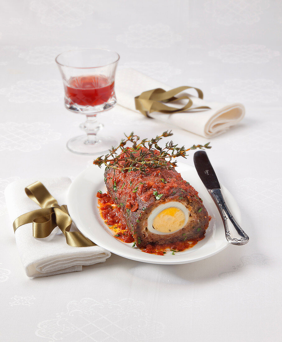 Polpettone di agnello (minced lamb meat loaf filled with egg, Italy)