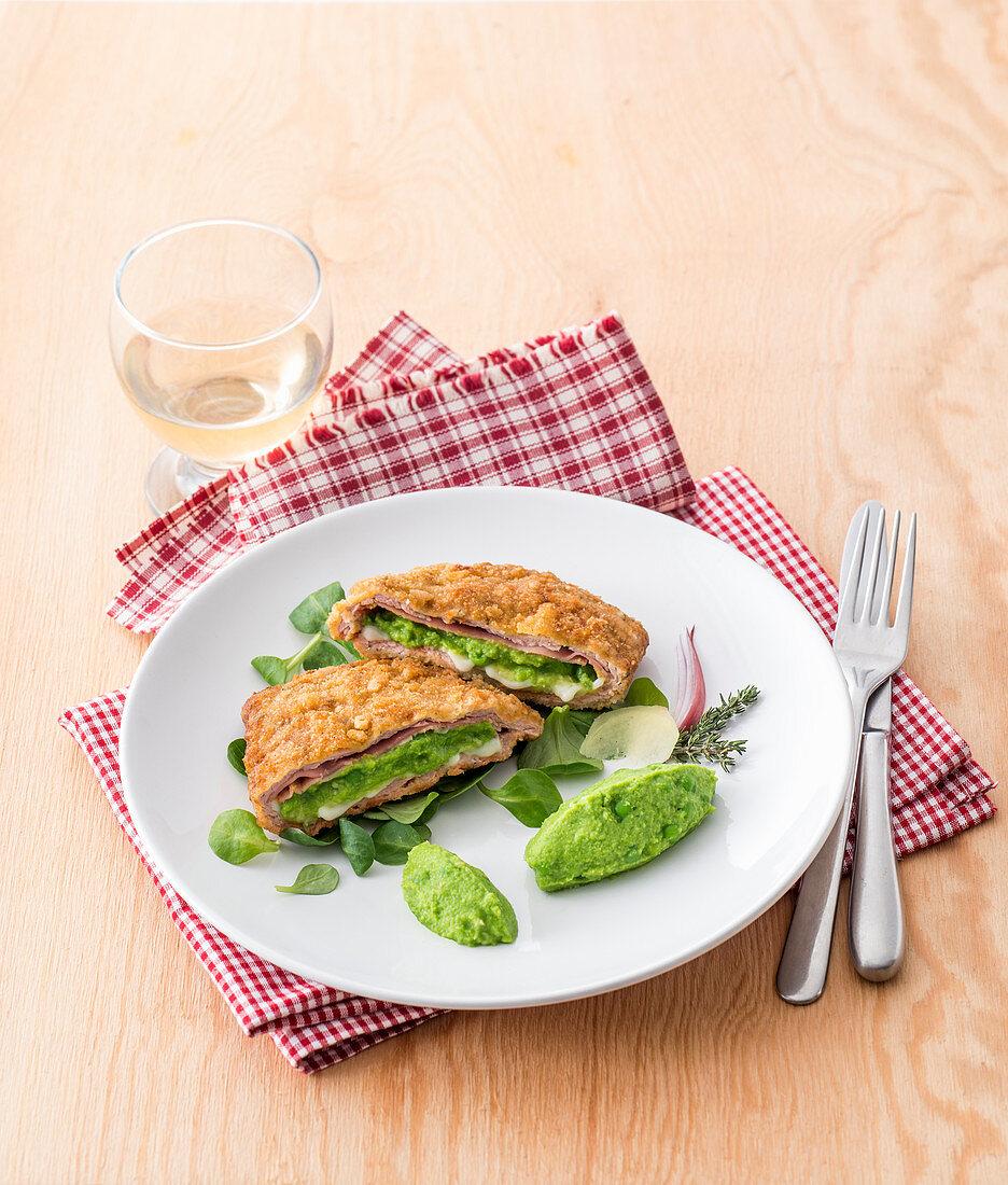 Cordon bleu with pea cream on lambs lettuce salad