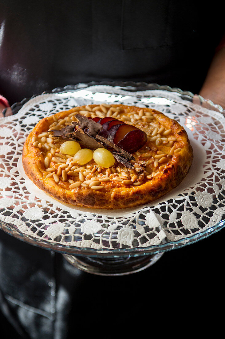 Homemade pie with pinenuts and plums