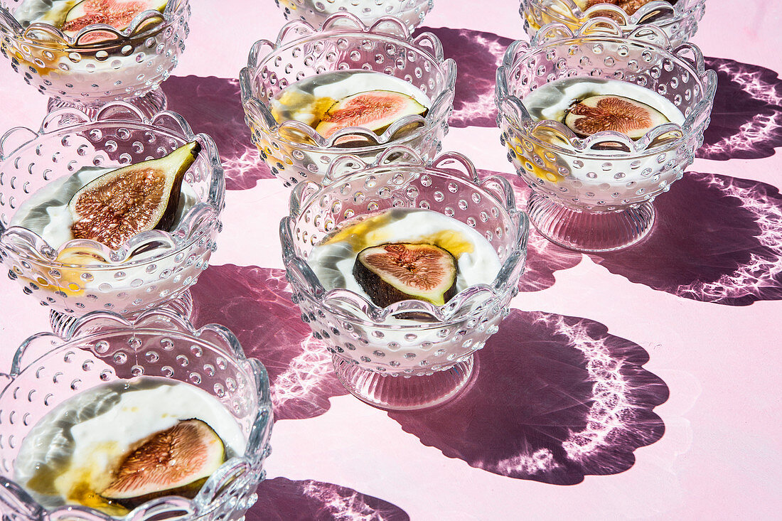 Yogurt with figs and honey in crystal glasses (India)