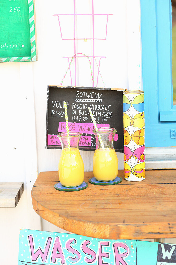 Summer mango yoghurt drinks outside on a bistro table