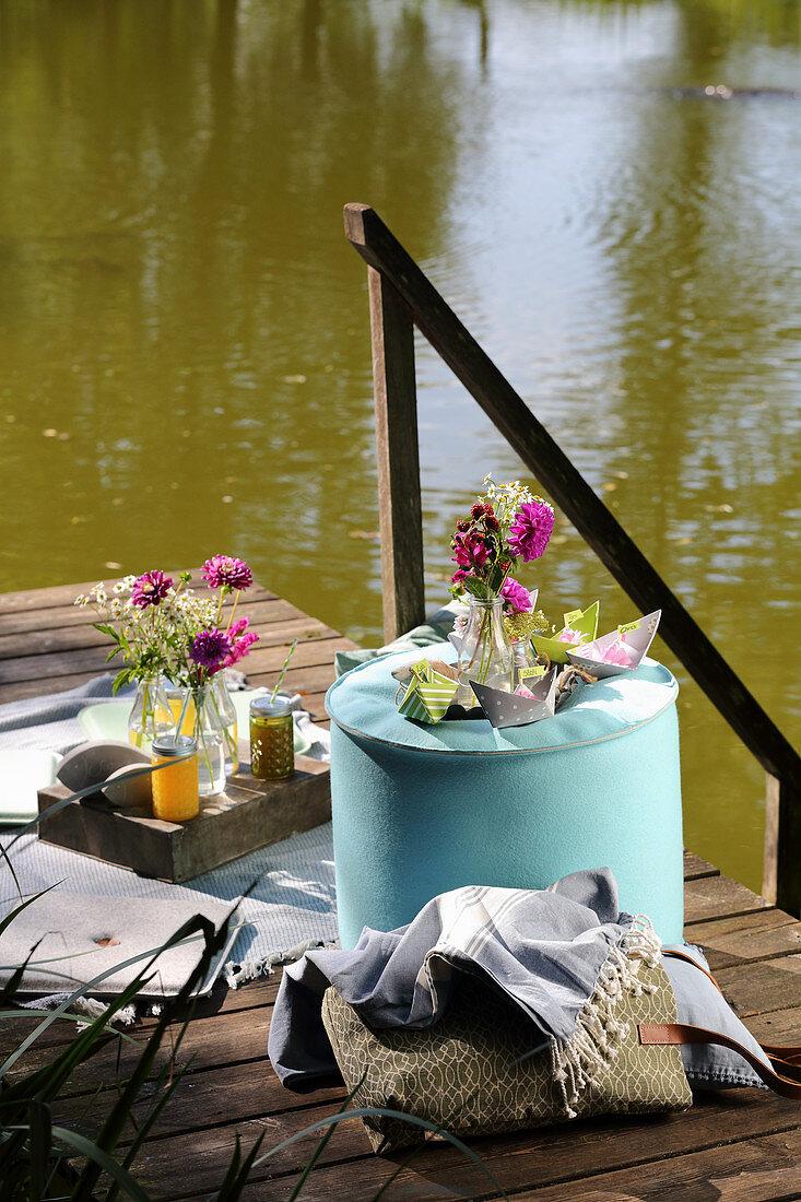 A picnic on a jetty by a lake