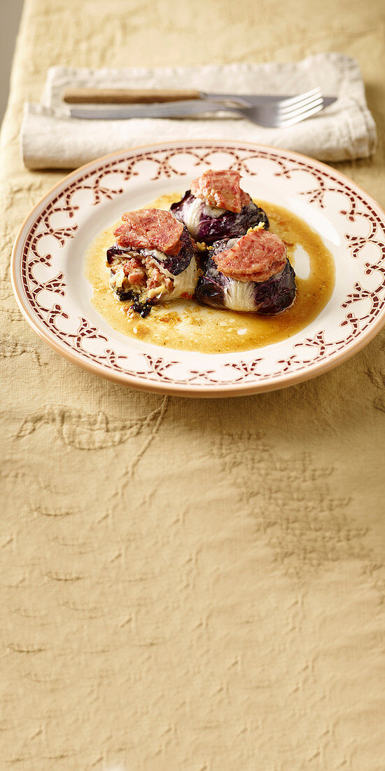 Radicchio roulades with cotechino bread filling