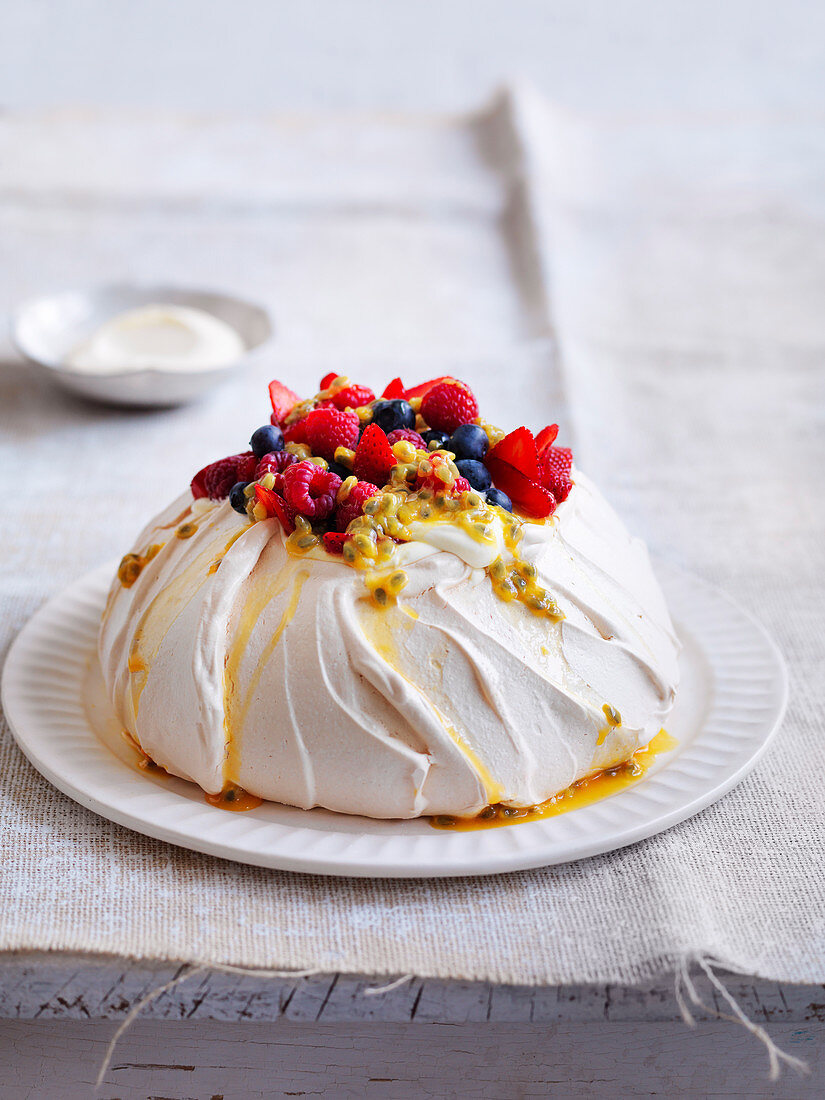 Pavlova with berries and passionfruit