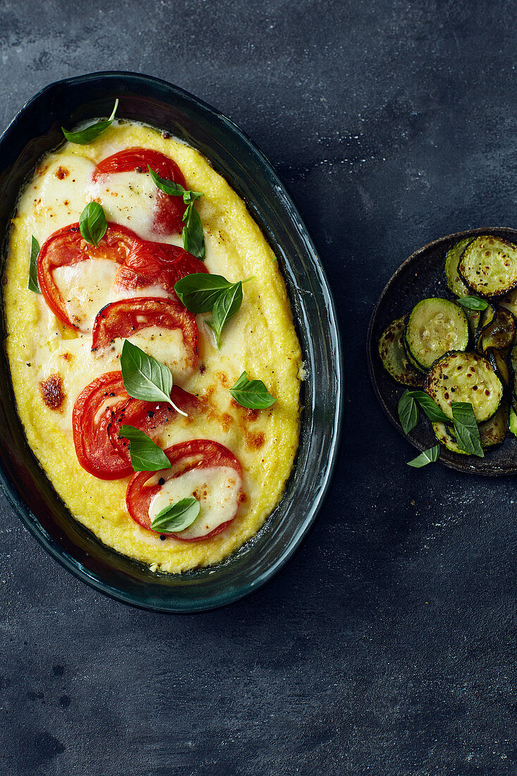 Gratinated polenta with tomatoes, courgettes and mozzarella
