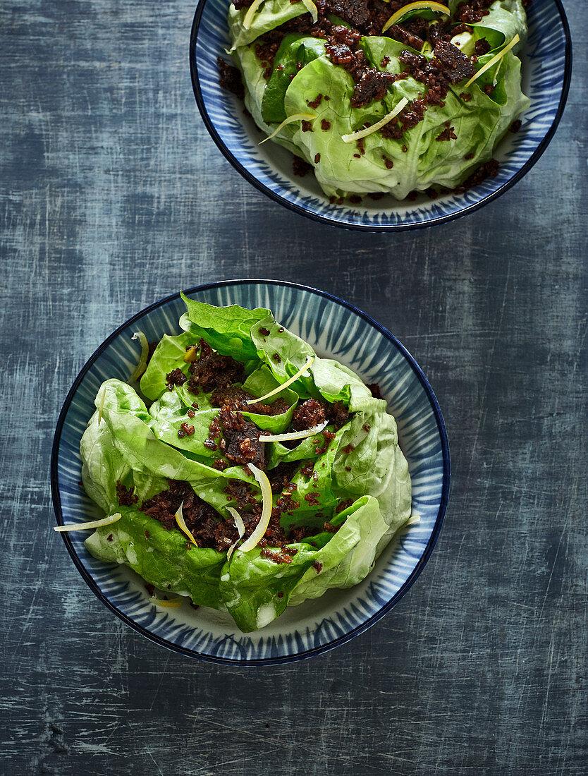 Lettuce with crispy pumpernickel crumbs and salted lemons