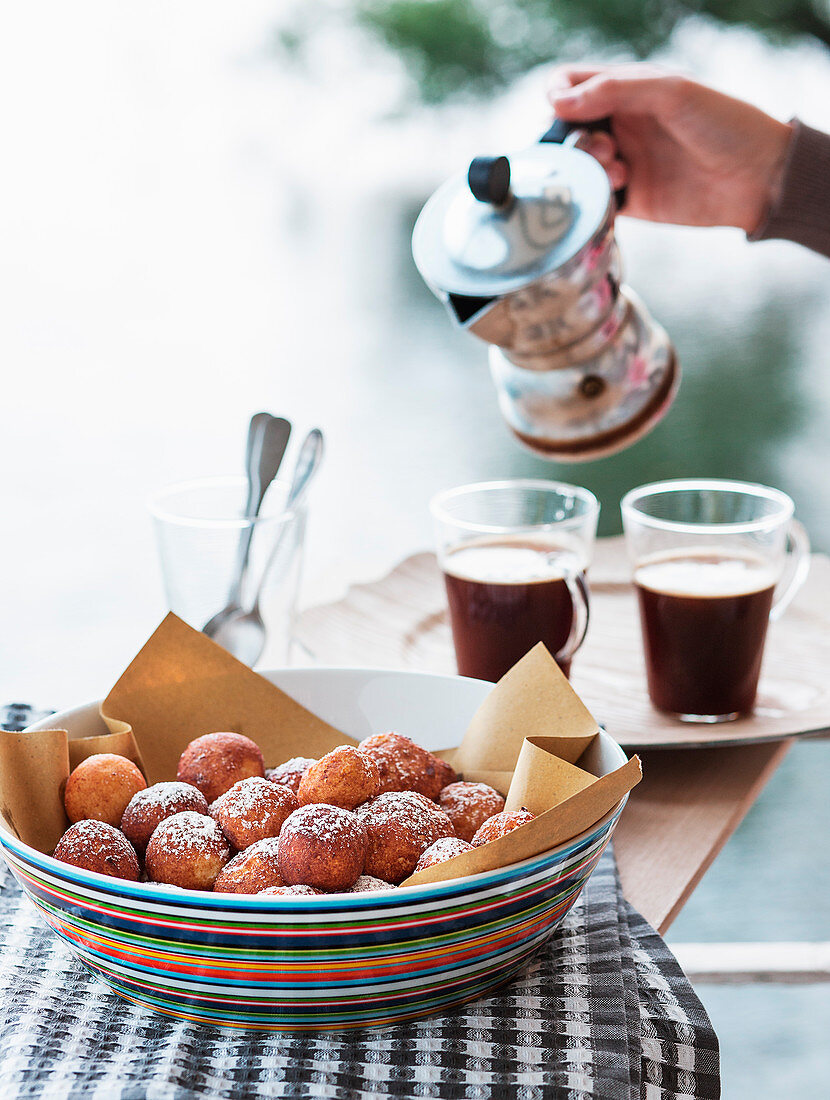 Chocolate and vanilla coffee with fried ricotta balls