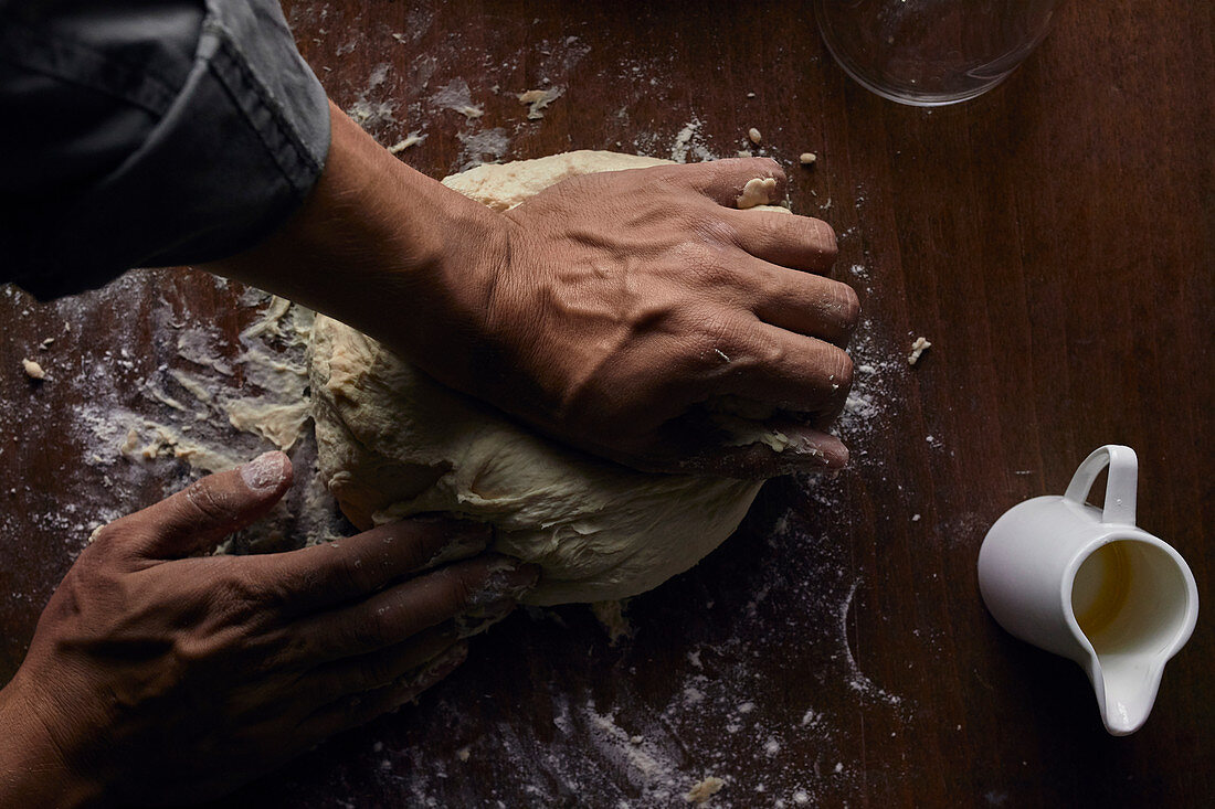 Kneading sourdough on the table