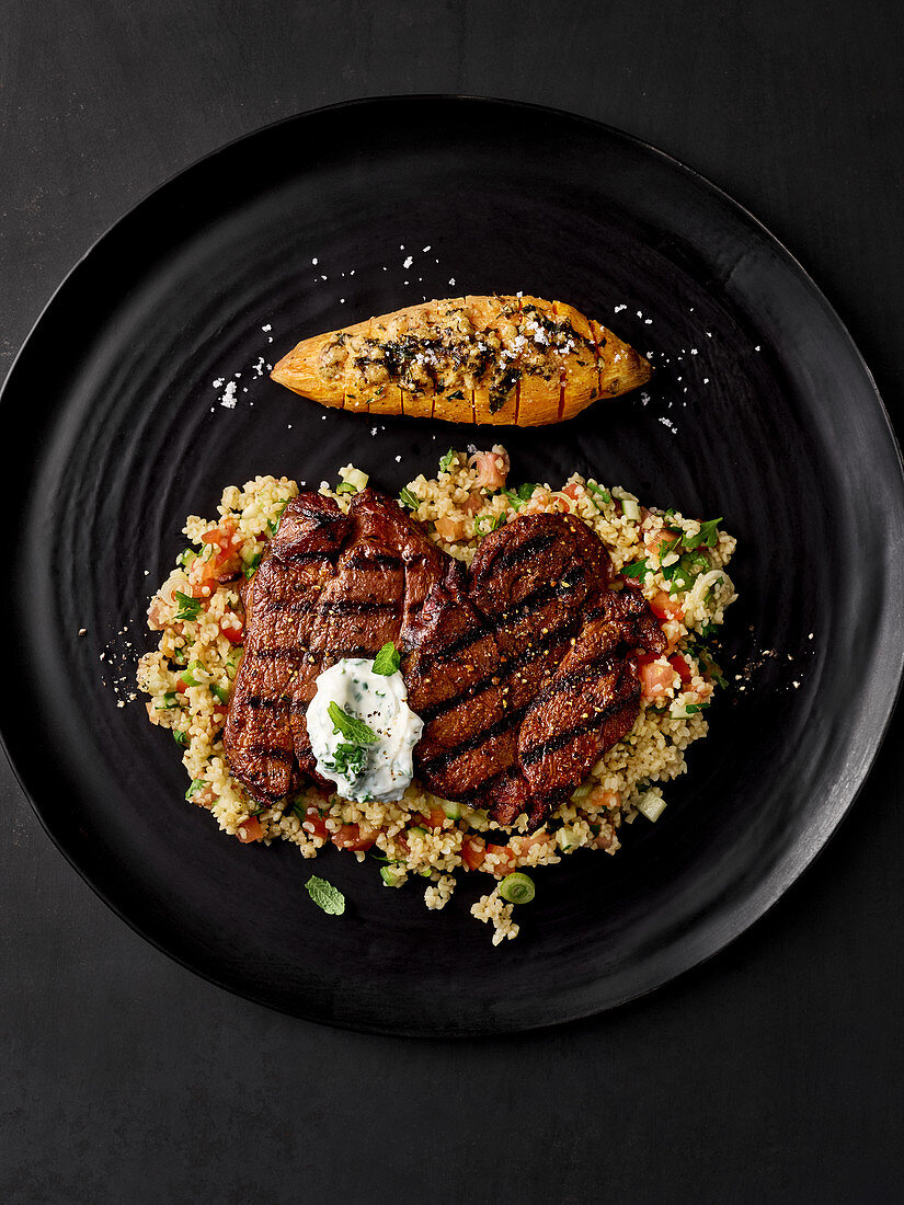 Grilled venison burgers with bulgur salad and sweet potatoes