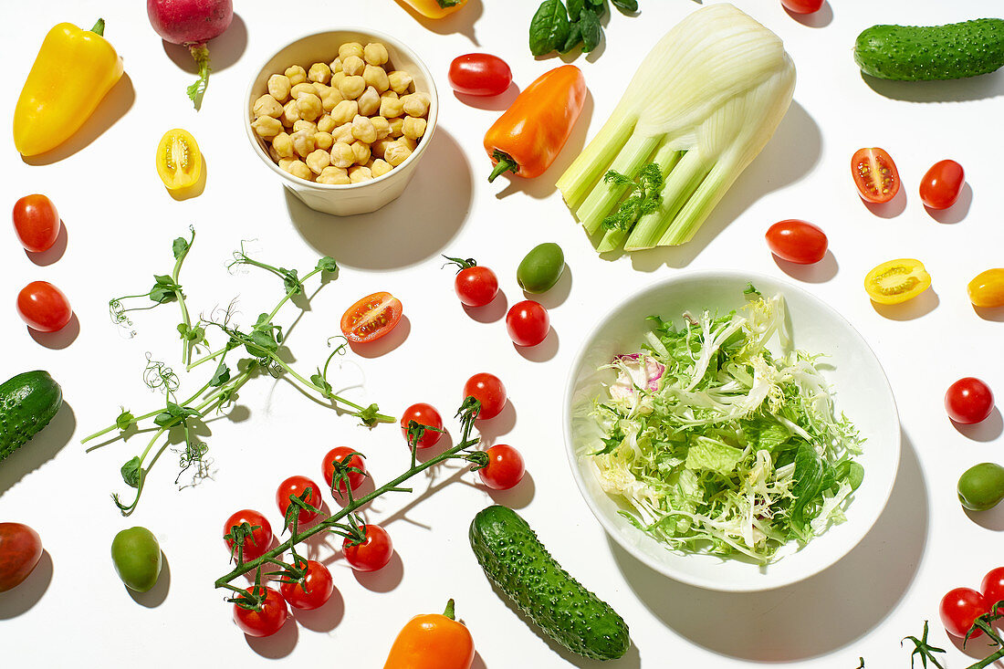 Healthy salad ingredients on white background
