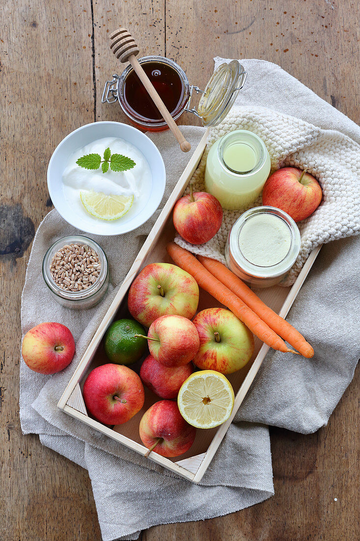 Whey with grains, yoghurt, honey, fruit and carrots