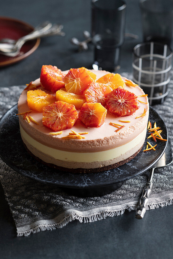 A layer cake with a duo of mousse au chocolat and orange cream