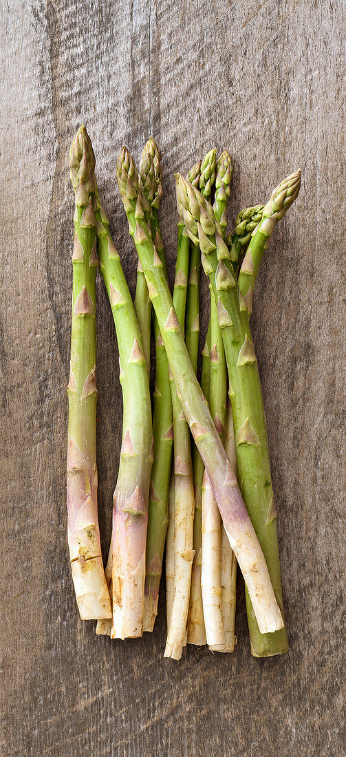 Green asparagus on a wooden surface