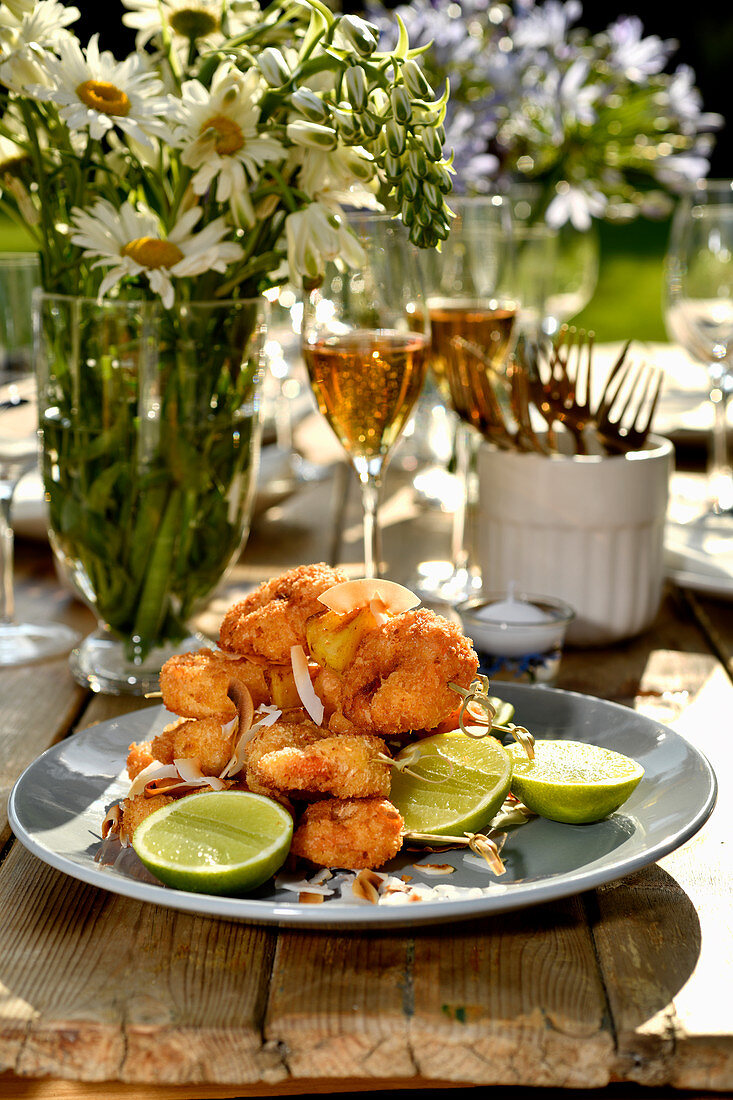 Panko and coconut prawns with pineapple on bamboo skewers