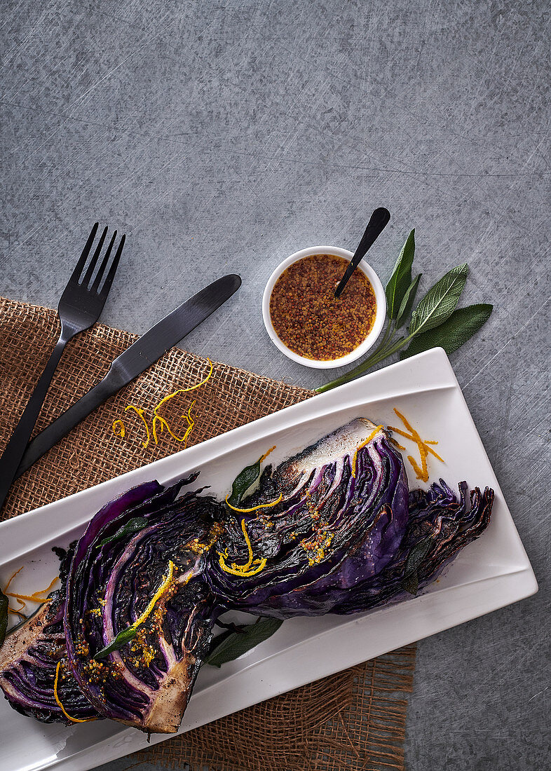 Roasted red cabbage wedges with wholegrain mustard and maple syrup dressing