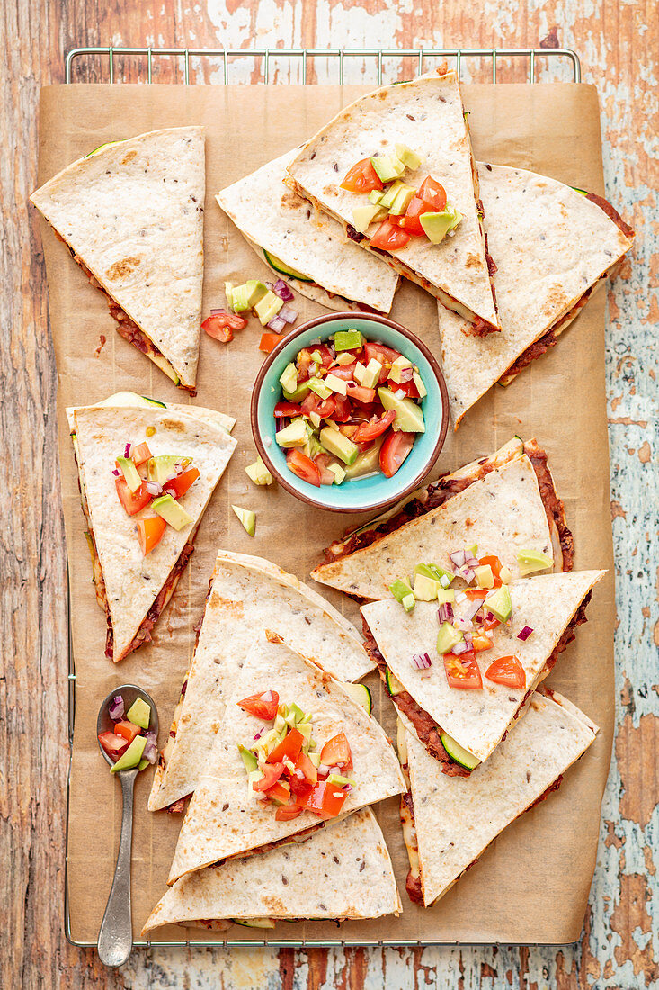 Quesadillas with red kindey beana, courgettea and avocado salsa