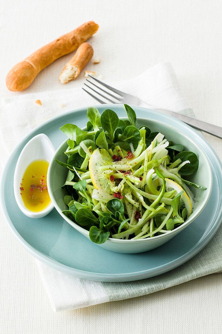 Green salad with puntarelle, lamb's lettuce, leek and lemon vinaigrette
