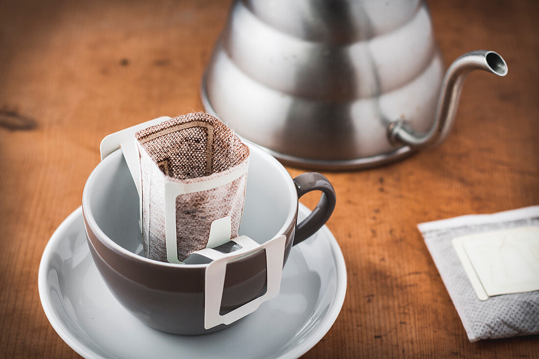 A coffee cup with a drip coffee bag