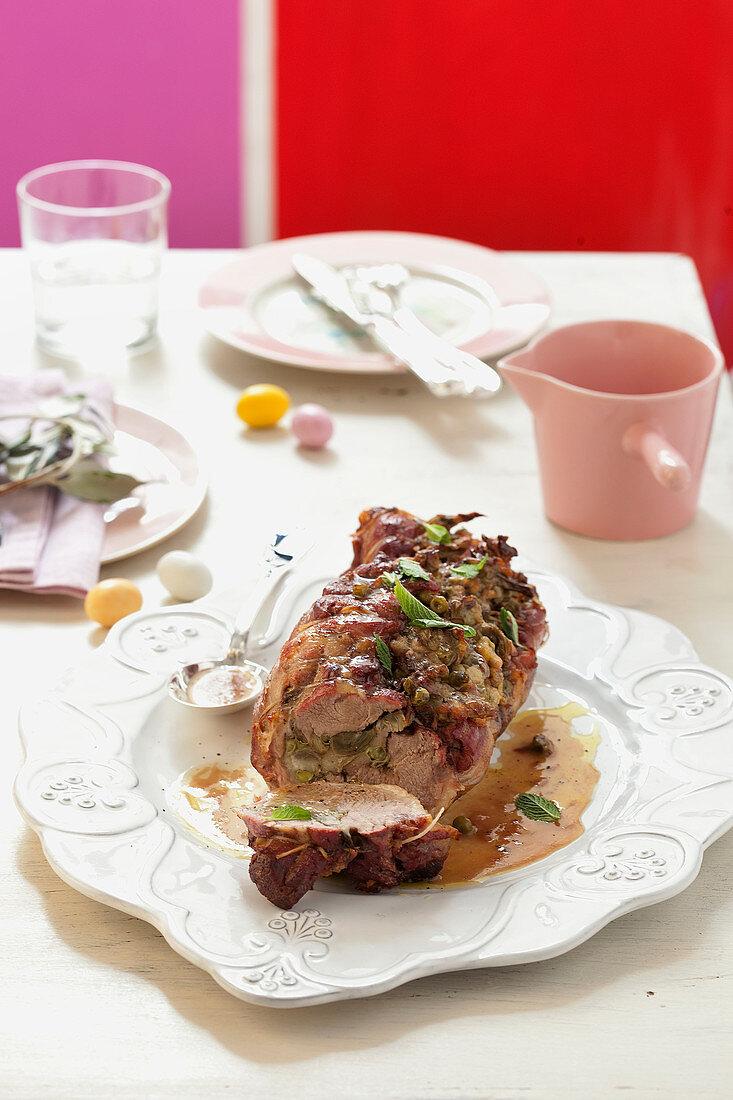 Roast lamb with artichoke stuffing
