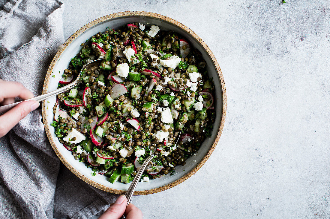 Radish, lime, cucumber and quinoa salad, served with soft cheese