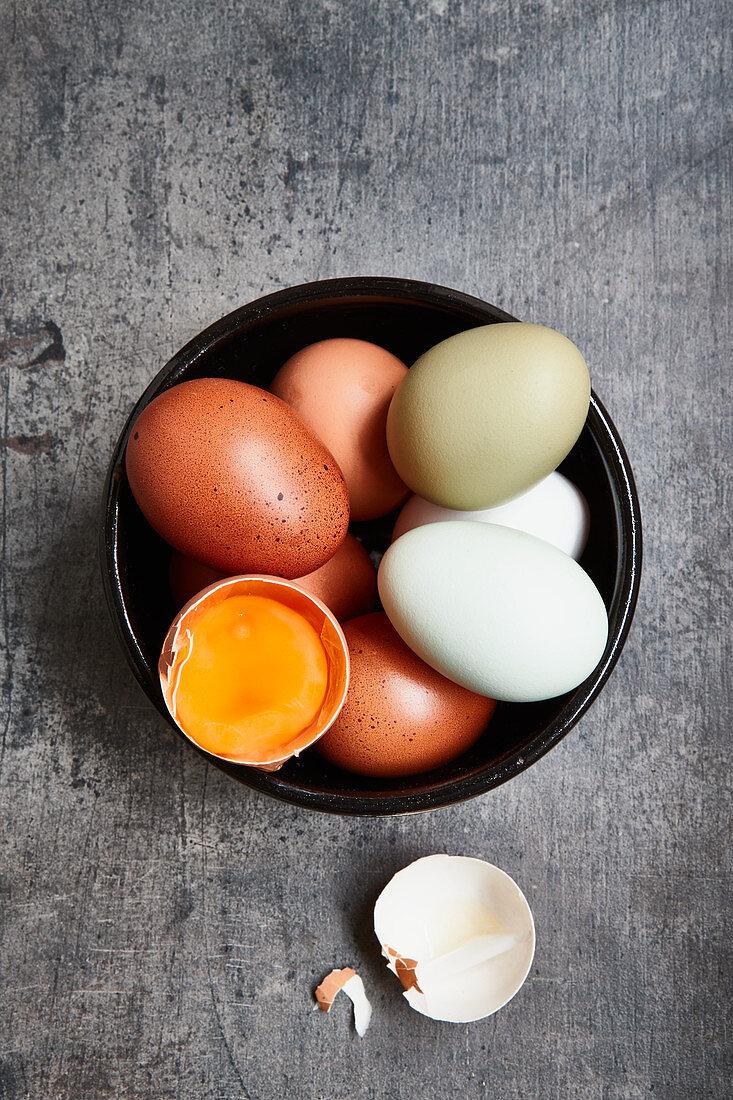 Fresh eggs, one cracked open