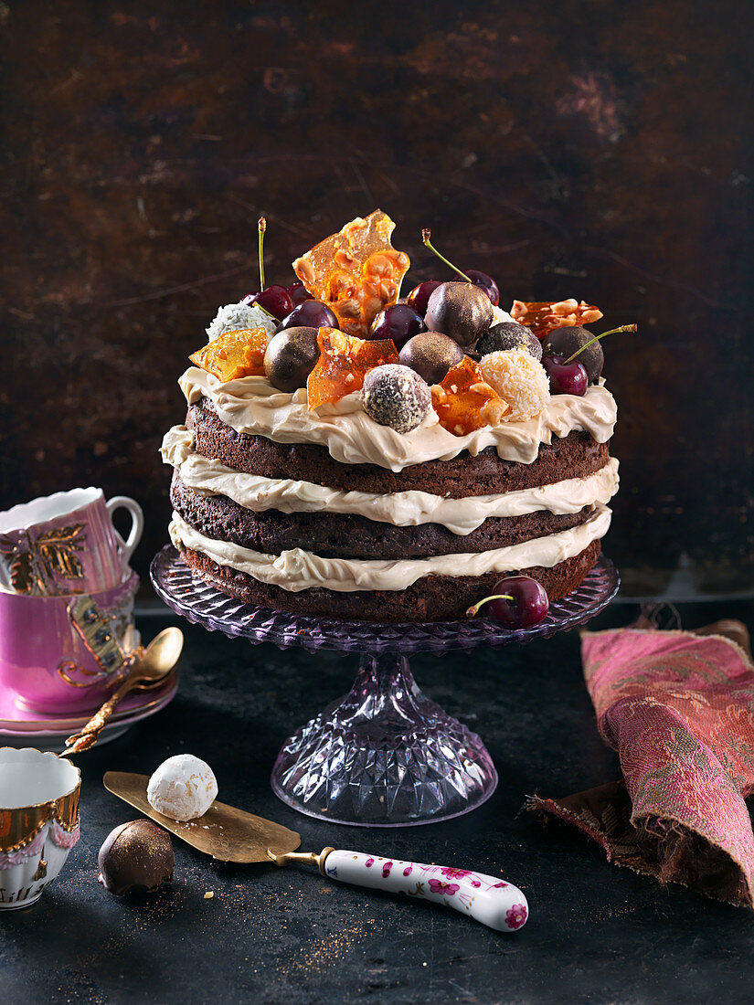 Chocolate cake deluxe with chocolat emousse, truffles, cherries and butterscotch