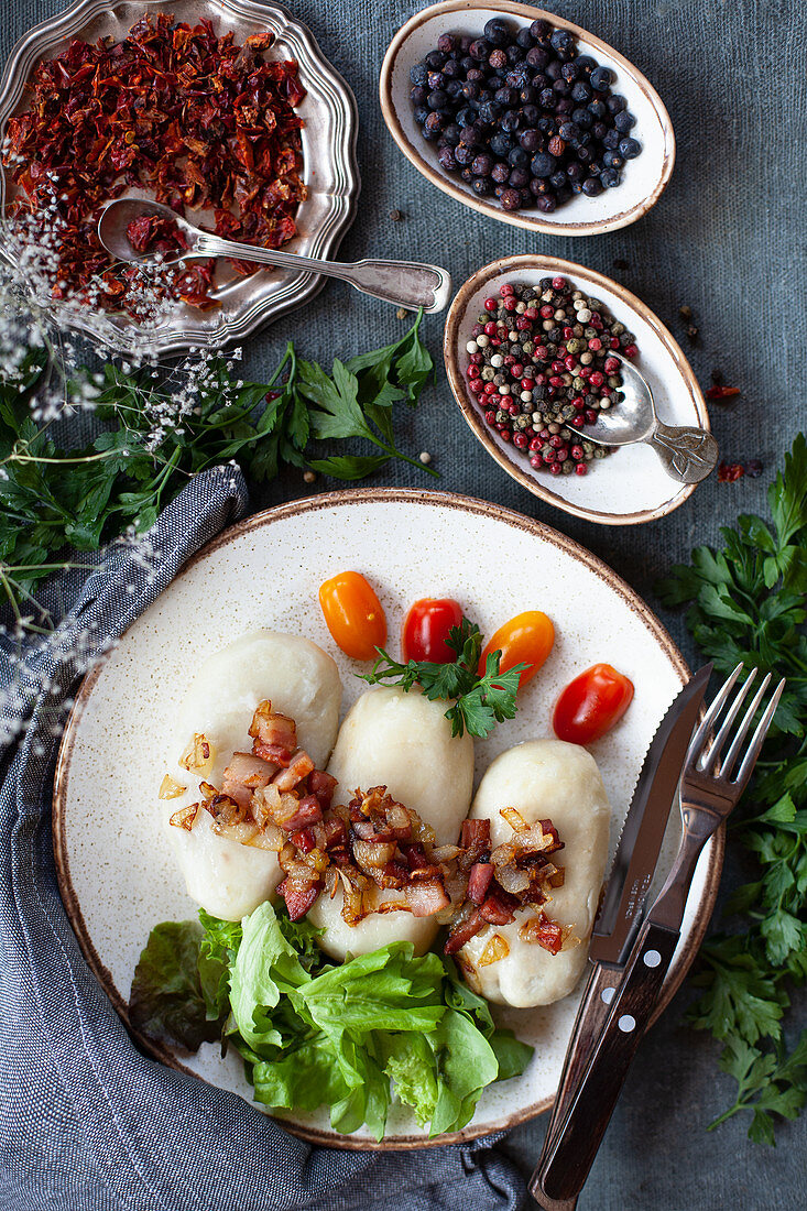 Lithuanian dumplings with meat bacon cracklings