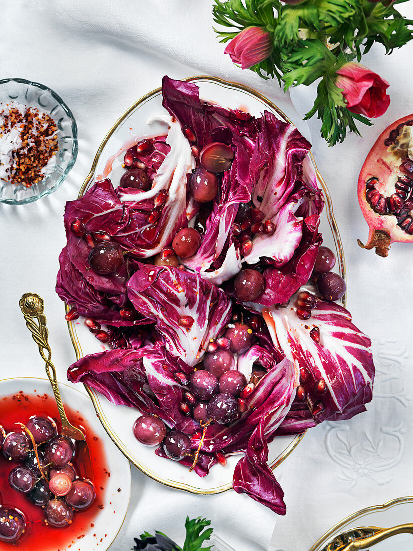 Red treviso salad with grapes, chilliflakes and pomergranate for Valentines day