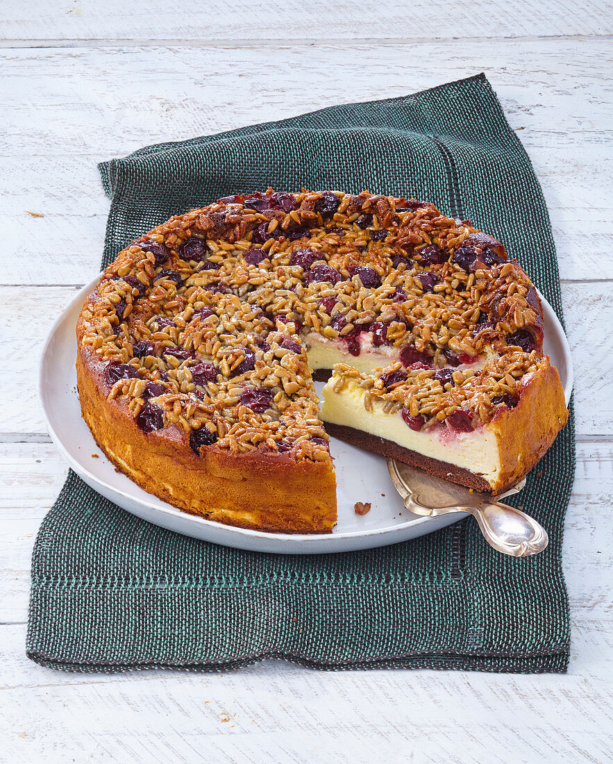 Cheesecake with sour cherries and sunflower crunch topping
