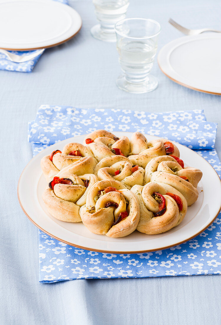 Rose bread with tomato and caper filling