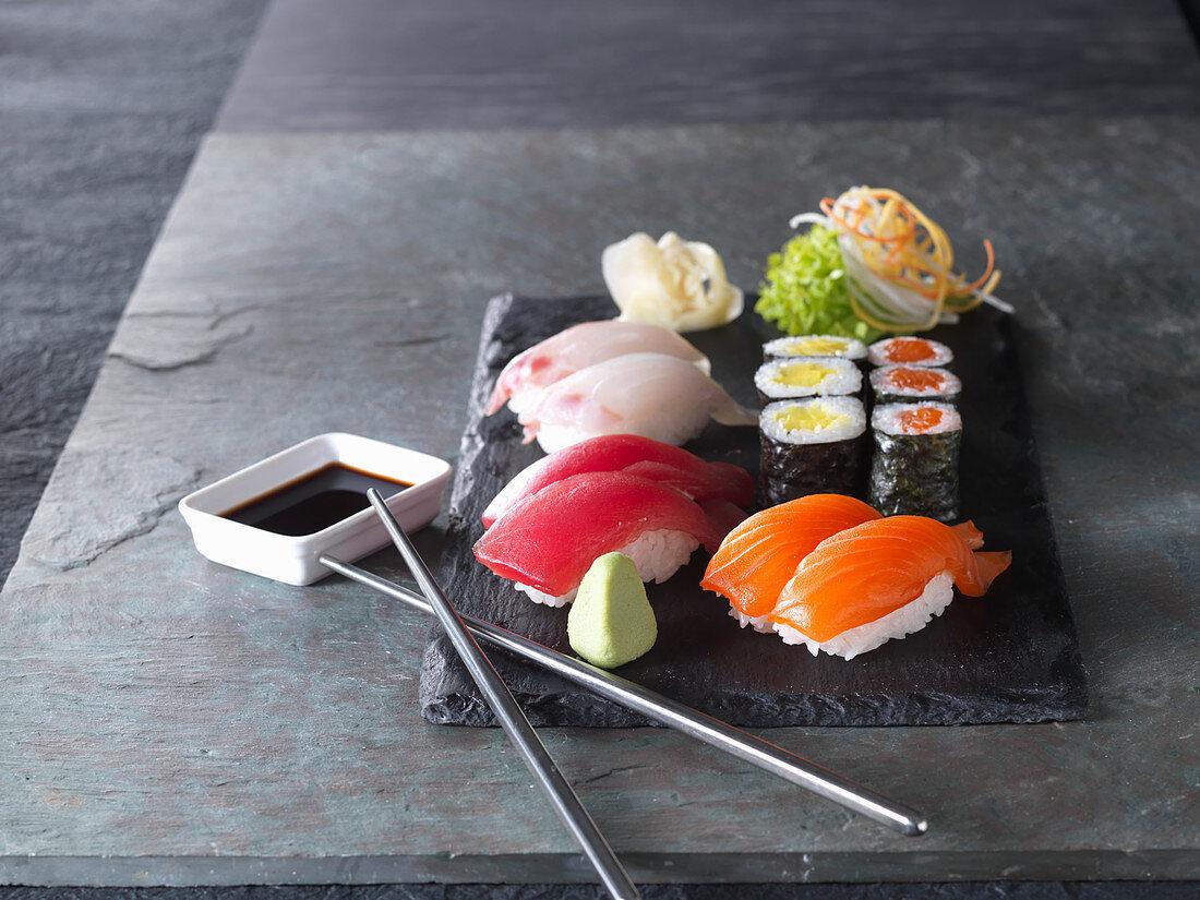 Nigiri sushi and maki with wasabi, soy sauce and ginger (Japan)