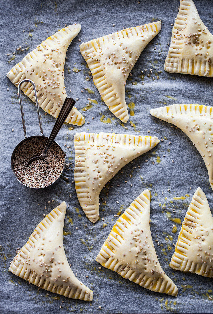 Savory pastries with sprinkled sesame seeds on top