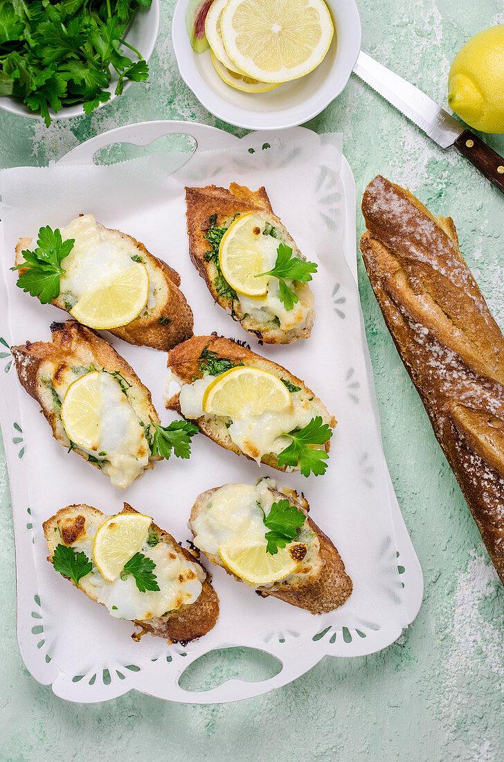 Bruschetta with cod, lemon and parsley