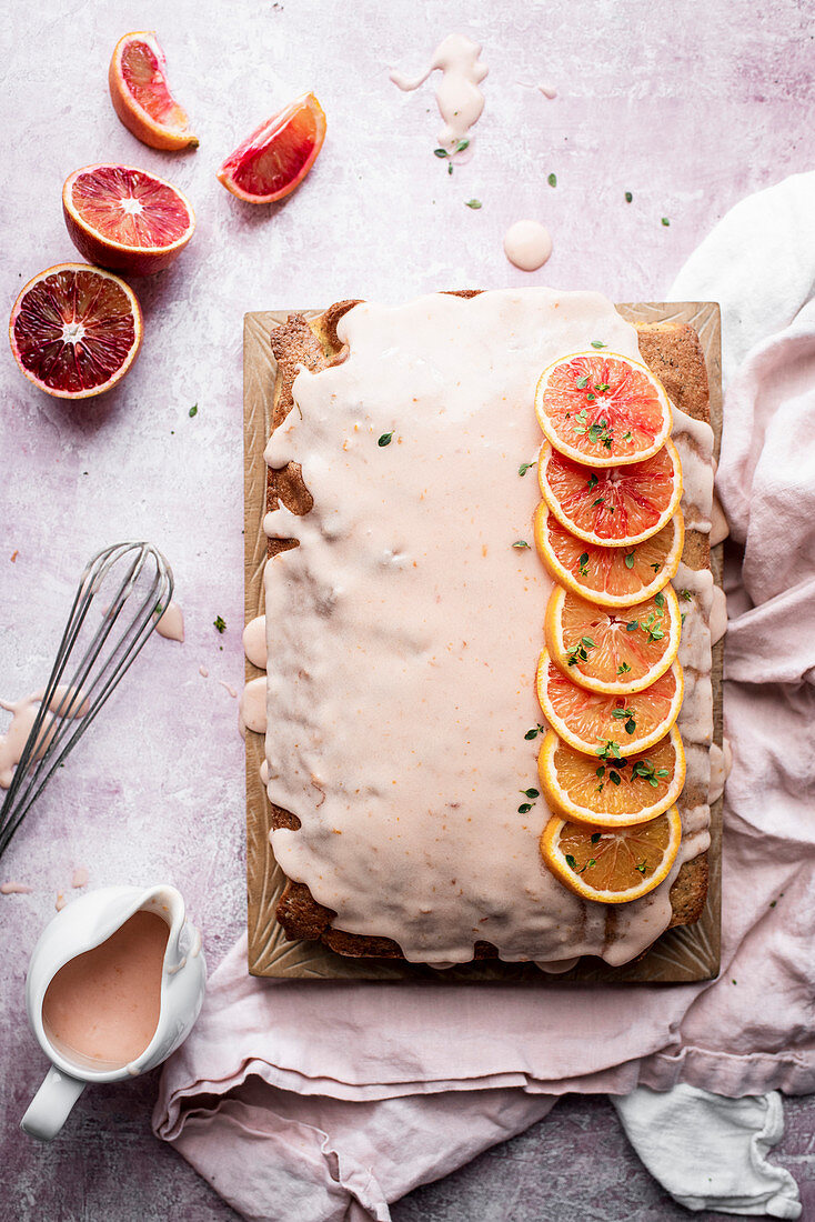 Poppy seed blood orange cake from a tin with icing
