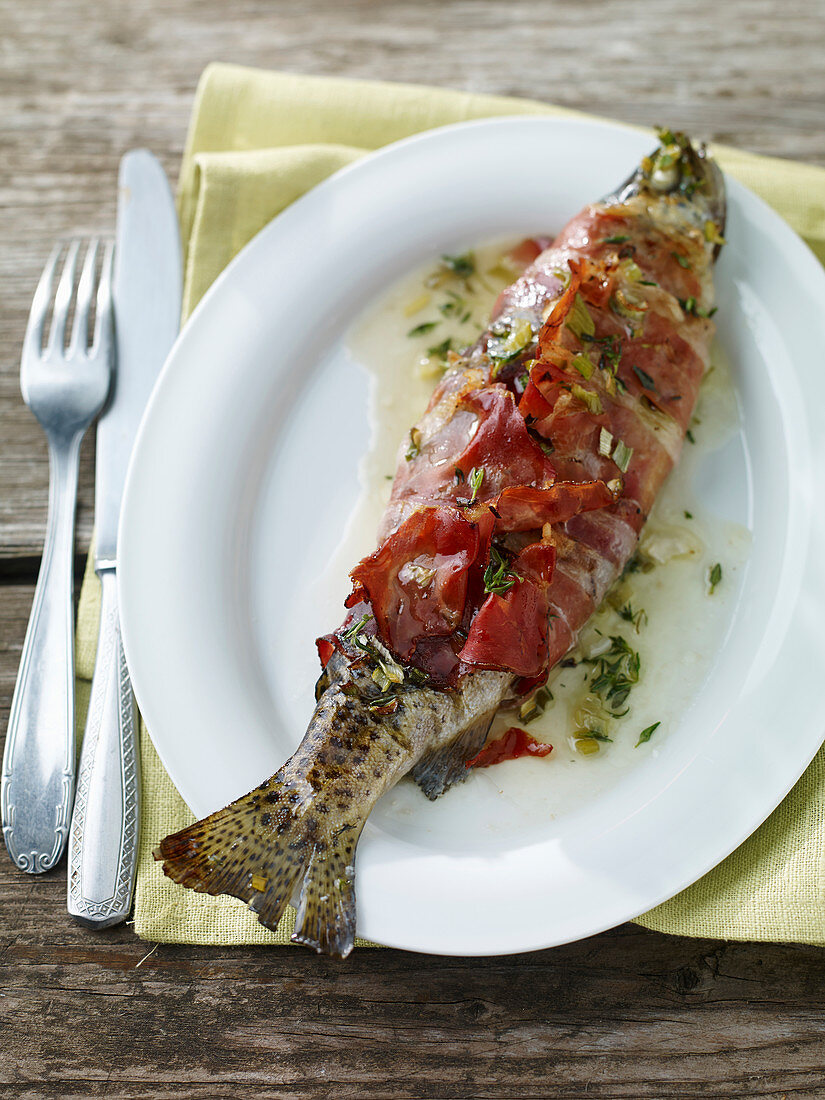 Trout wrapped in bacon with grappa butter