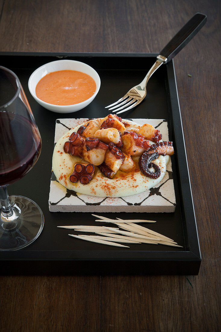 Galician-style braised octopus on mashed potatoes with pepper aioli