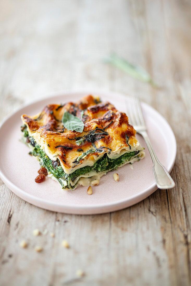 Lasagne with spinach, pine nuts, gorgonzola, sage and raisins