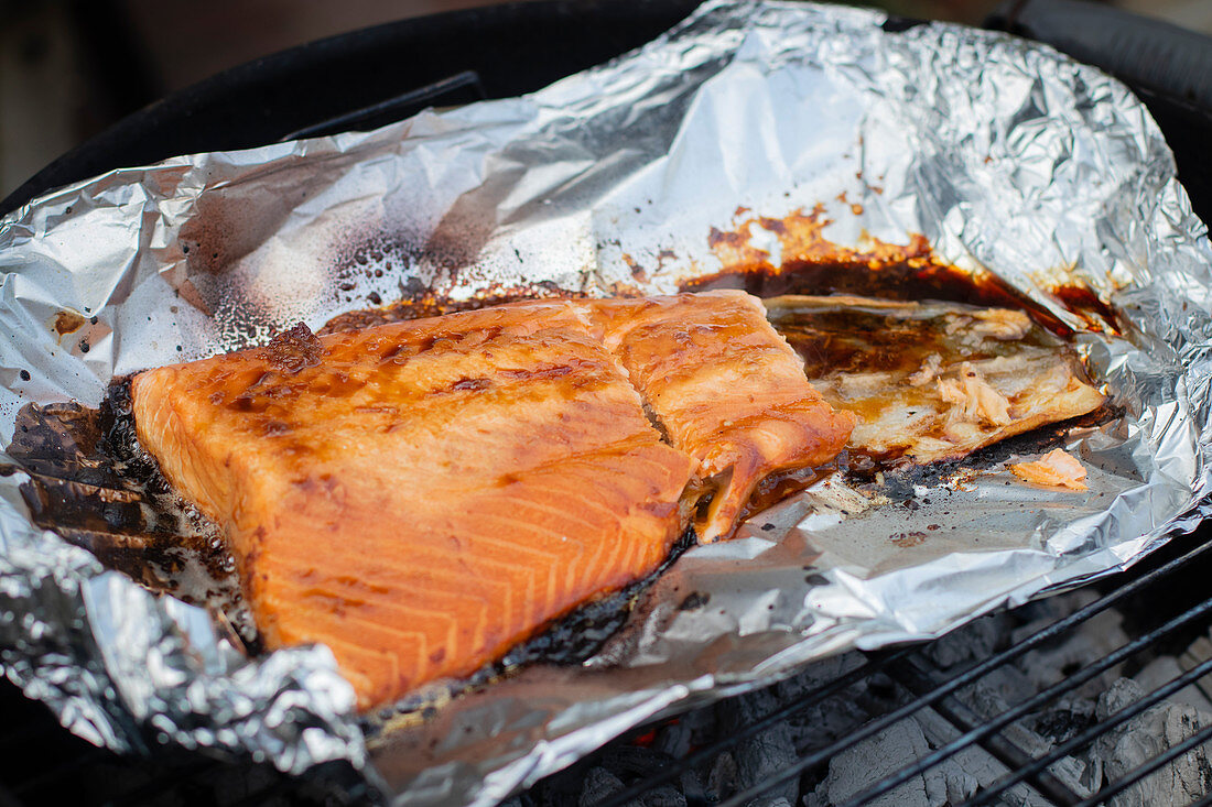 Marinated salmon on the BBQ in foil