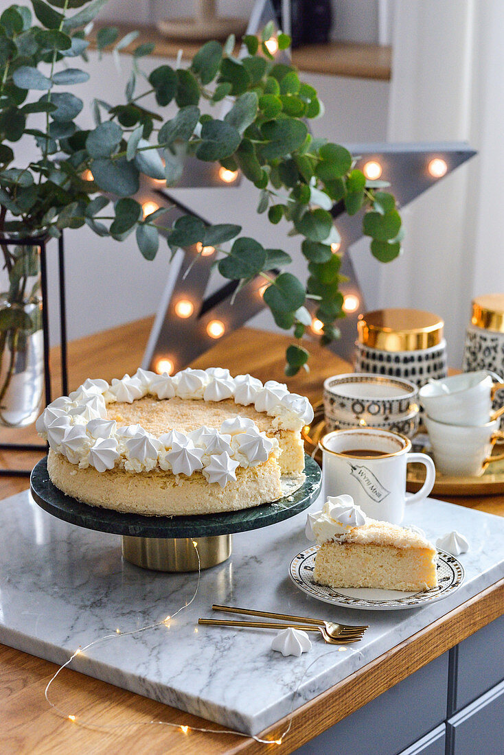 Coconut cheesecake on a plate in the kitchen