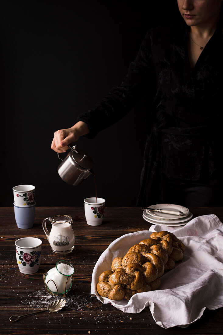 Challah and coffee on wooden table