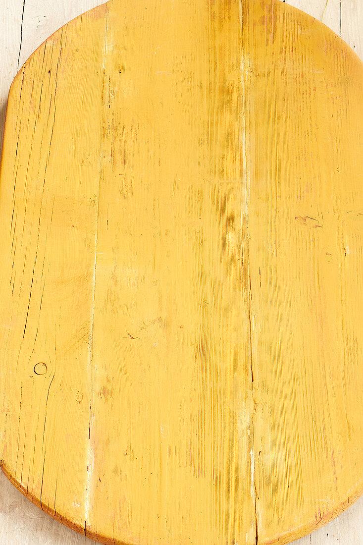 Yellow glazed wood background